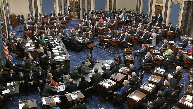 In this image from video, Senators vote on the first article of impeachment during the impeachment trial against President Donald Trump in the Senate at the U.S. Capitol in Washington, Wednesday, Feb. 5, 2020.