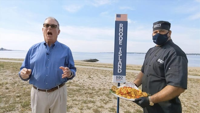 In this image from video, Joseph McNamara of Rhode Island speaks during the state roll call vote on second night of the Democratic National Convention on Tuesday. At right is John Bordieri, executive chef at Iggy's Boardwalk on Oakland Beach in Warwick.