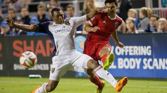 Real Salt Lake's Jordan Allen, tries to win a ball from San Jose Earthquakes midfielder Shea Salinas.