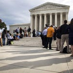 In this Oct. 13, 2015 file photo, people line up outside of the Supreme Court in Washington, Tuesday, Oct. 13, 2015, as the justices began to discuss sentences for young prison 'lifers.' A decision in Montgomery v. Louisiana. The Supreme Court ruled Monday, Jan. 25, 2016, that people serving life terms for murders they committed as teenagers must have a chance to seek their freedom. The court ruled in the case of Henry Montgomery, who has been in prison more than 50 years, since he killed a sheriff's deputy as a 17-year-old in Baton Rouge, Louisiana, in 1963.