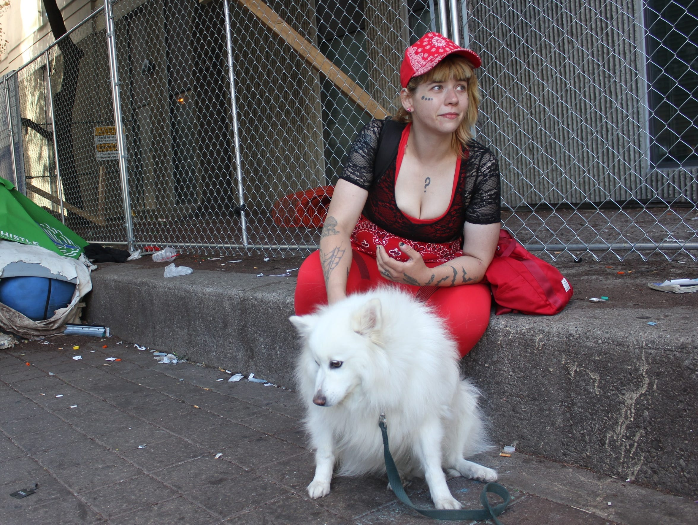 Brooke Fuller, 25, pets a friend's dog outside a supervised
