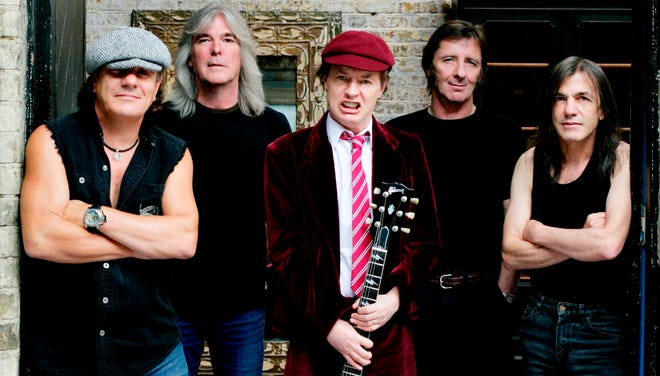 Members of the group AC/DC, left to right:  Brian Johnson, Cliff Williams, Angus Young, Phil Rudd and Malcolm Young.