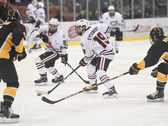 Mikey Eyssimont controls the puck for St Cloud State