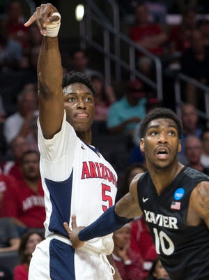 Arizona Wildcats forward Stanley Johnson hits a three-pointer against Xavier on March 26, 2015.