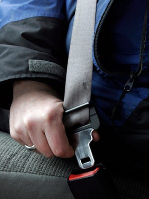 A person buckles up in Bethel, Maine, on Monday, March 31, 2008. Maine's Bureau of Highway Safety has been getting the word out to motor vehicle operators that the law changes as of April  1, so first-time violators can get $50 tickets. Second violations can bring $125 fines, and third and subsequent offenses can lead to $25 fines.Since last September, violators got only warnings.(AP Photo/Pat Wellenbach)