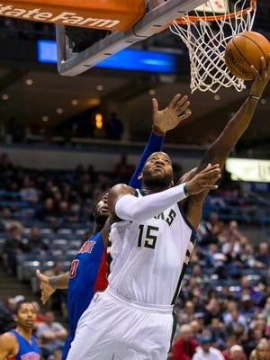 Bucks center Greg Monroe (15) shoots in front of Pistons center Andre Drummond (0) during the third quarter of the Pistons' 109-88 loss Monday in Milwaukee.