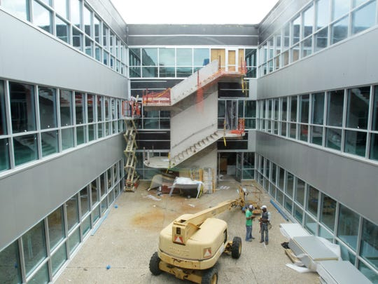 Construction continues in the Fletcher Hall courtyard at UL Monday, June  30, 2014.