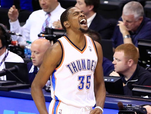 Game 7 in Oklahoma City -- Thunder 120, Grizzlies 109: Oklahoma City star Kevin Durant celebrates a second-half three-pointer.