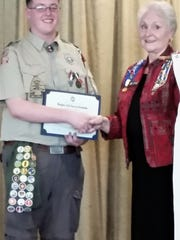 Jersey Blue DAR Chapter Past Regent Susan Luczupresents a Youth Good Citizenship award certificate and pin to Andrew Lawrence.