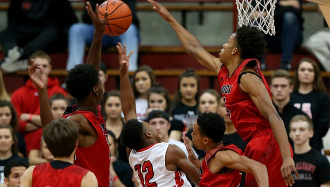 New Albany's Romeo Langford (right) blocked a shot by Pike's Justin Thomas (12) during the Tip Off Classic in December.