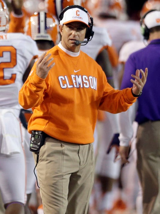 Clemson head coach Dabo Swinney reacts to a call during the first half of an NCAA college football game against Wake Forest in Winston-Salem, N.C., Thursday, Nov. 6, 2014. (AP Photo/Chuck Burton)
