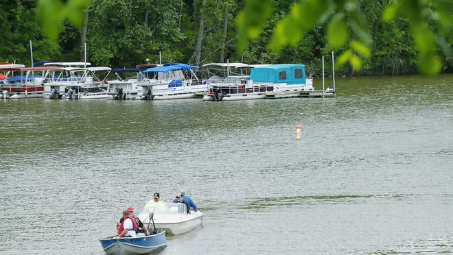 Boats make their way around Charles Mill Lake on a May afternoon.