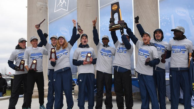 The Northern Arizona men's cross country team celebrates winning the first NCAA championship in school history on Nov. 19.