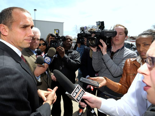 Macomb County Prosecutor Eric Smith briefly addresses members of the media after the arraignment.