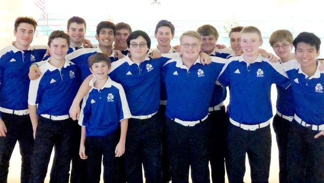 Catholic Central bowlers are all smiles after beating defending league champ DeLaSalle.