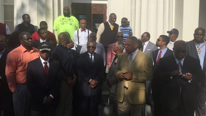 Ministers and business owners urge more city and county business for African-American companies.