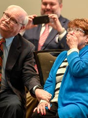 Evansville attorneys Brian and Barbara Williams react as they watch a video about their careers after they were named the Rotary Club of Evansville's annual Civic Award winners for 2016 on Tuesday, April 18, 2017.