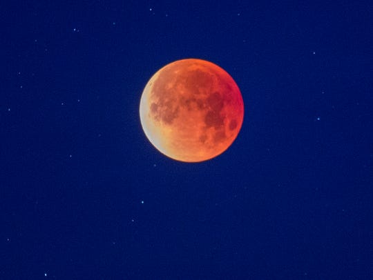 A so-called 'super blue blood moon' is seen in total eclipse above the Mojave Desert on January 31, 2018 near Amboy, California.  The super wolf blood moon will be visible Sunday, Jan. 20.