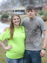 Cynthia and Justin Leasure stand in front of John Lowe's house in Milan. Justin, who lives in Memphis, served with John overseas, and also has had trouble finding a good job.