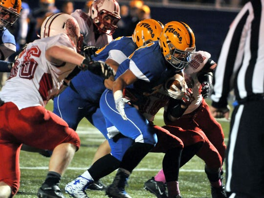 Clyde's Frank Sewell carries the ball into the endzone during the Fliers homecoming game versus Port Clinton on Friday Ocotber 16, 2015.