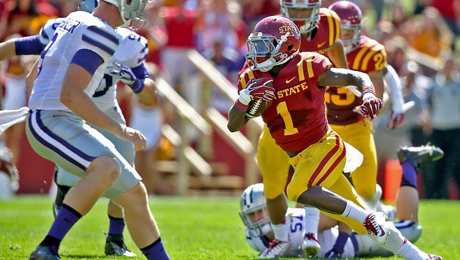 Iowa State's Jarvis West, right, makes a sharp cut to the center of the field to elude Kansas State defenders on Sept. 6, 2014.