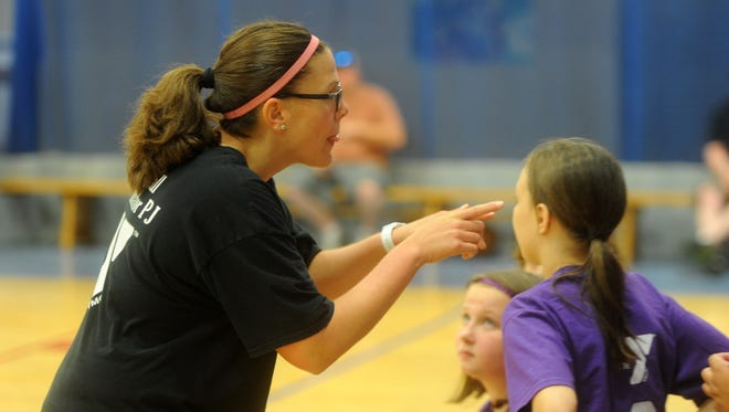 Priscilla Jenkins gives instructions to her team during a volleyball game Wednesday at the Staunton-Augusta YMCA. Jenkins created the program almost seven years ago.