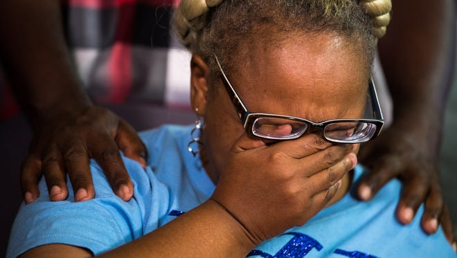 Vickie Hambrick, mother of Daniel Hambrick, wipes away tears during a news conference  Aug. 8, 2018, addressing the video released of the death of her son.