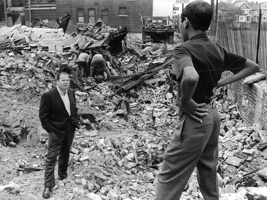 Detroit Mayor Jerome Cavanagh speaks to a young man on Detroit 's east side in September 1967 after the Detroit riots in July of 1967. The young man tells the mayor the rubble had been a five and ten cent store.
