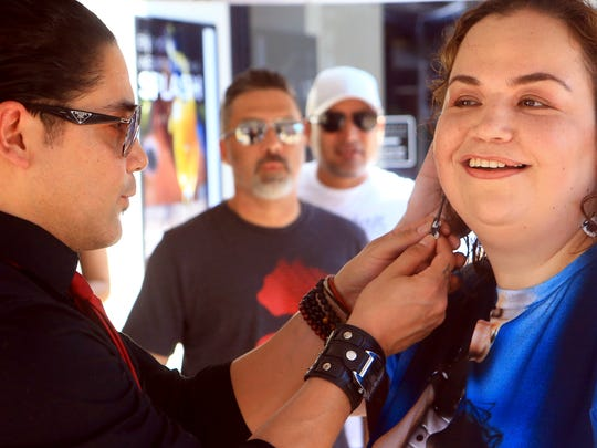 Guitarist Chris Perez views guitar earrings from fan Nora Gonalez during the South Texas Music Walk of Fame on Saturday, June 3, 2017, at the Water Street Market in Corpus Christi.