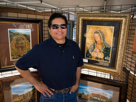 Painter Art Perez stands in his booth at Mesilla's