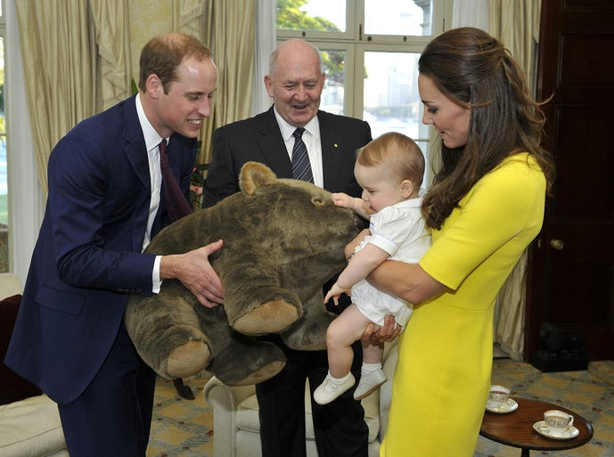 A plush wombat presented by Sir Peter Cosgrove, governor-general of Australia, brought a smile to baby Prince George's face when he arrived in Sydney on April 16. A growing haul of goodies are being given to George and his parents, Prince William and Kate, Duchess of Cambridge, during their three-week tour of New Zealand and Australia.