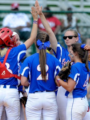 A Macon East meeting on the mound during the AISA State Softball Tournament at Lagoon Park in Montgomery, Ala. on Saturday May 3, 2014.