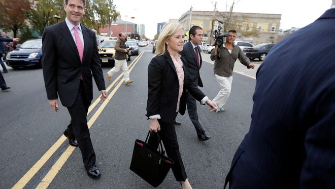 Former aides to Gov. Chris Christie, Bill Baroni, left, and Bridget Anne Kelly, center, filed separate motions Friday for new trials in the Bridgegate scandal.