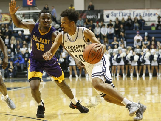 Albany Great Danes forward Devonte Campbell (12) defends