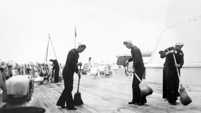 USSAZ- USS Arizona --Crew members sweep the deck of the USS Arizona. The USS Arizona's decks were made from teakwood and had to be meticulously maintained to protect from damage from the sea water and weather. Photo courtesy of the University of Arizona Special Collections