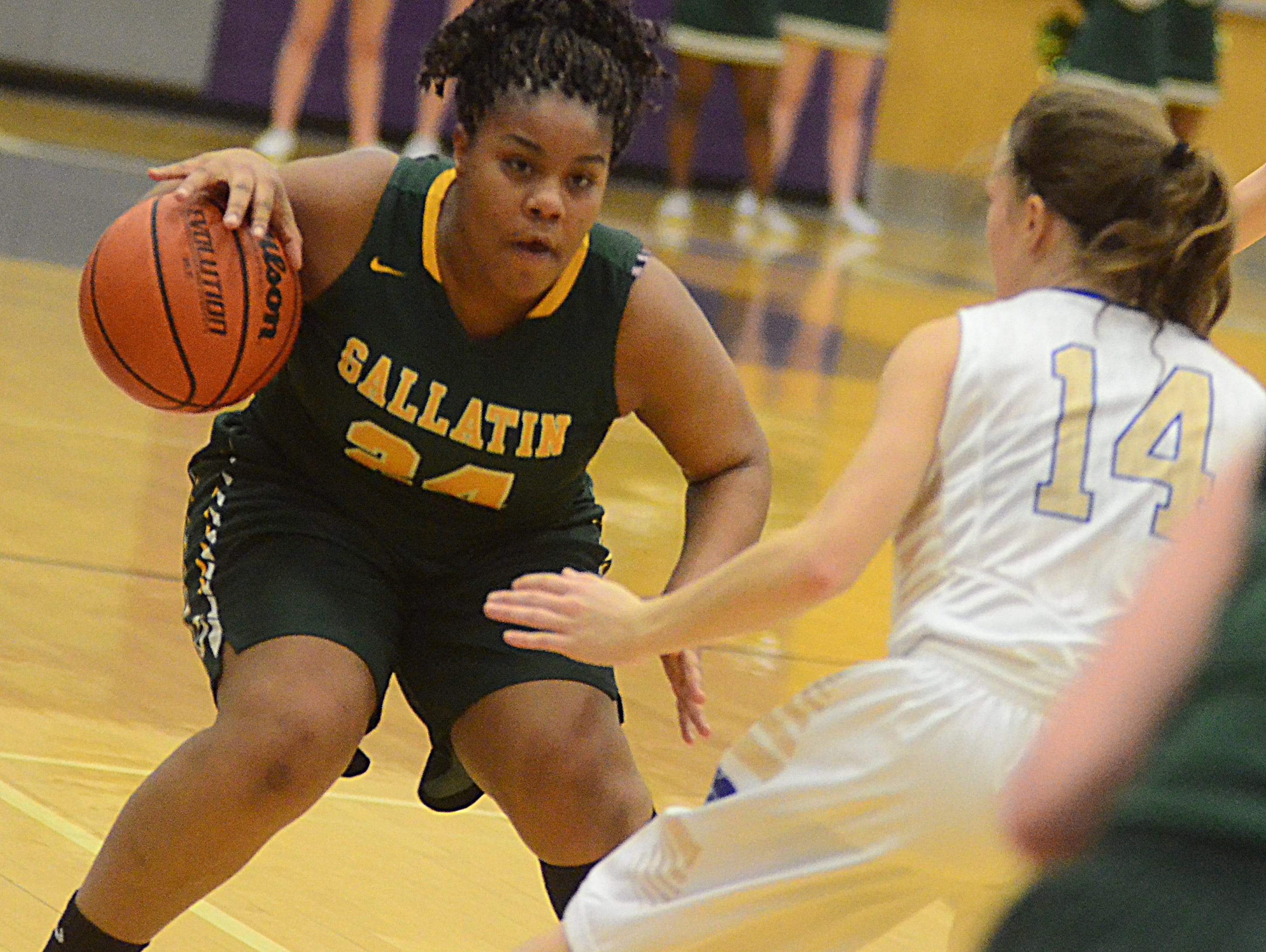 Gallatin High sophomore forward LaMonica Mintlow dribbles in the frontcourt as Wilson Central junior Anna Altman defends during first-quarter action.