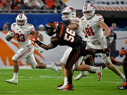A mauling Wisconsin offensive line should be able to push running back Jonathan Taylor (23) toward another 2,000-yard season in 2018. (Or at least 1,500.)