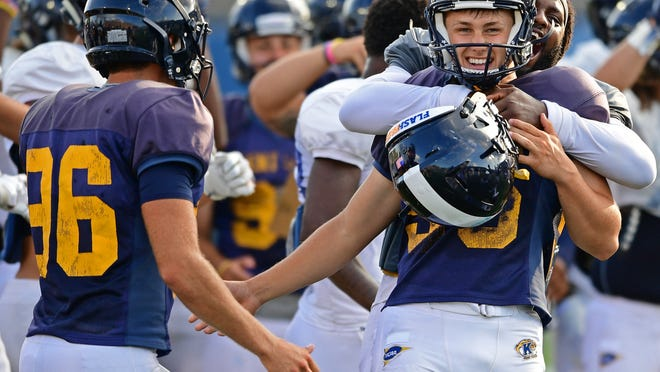 Kent State's Matthew Trickett is congratulated by his teammates after converting a long field goal attempt during a scrimmage in August 2019 at Dix Stadium.