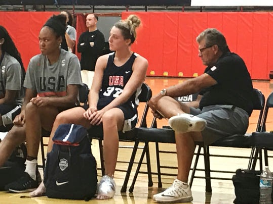 Connecticut head coach Geno Auriemma, from right, Katie Lou Samuelson, Azura Stevens and other players attend the Under-23 USA Basketball training camp in Colorado Springs, Colo., Tuesday, Aug. 1, 2017. (AP Photo/Doug Feinberg)