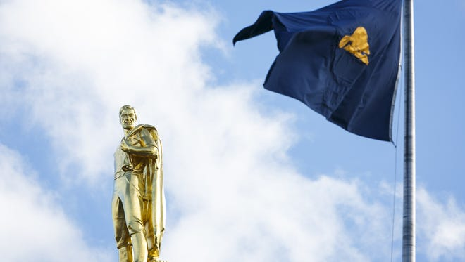 Blue skies and sun light up the Capitol's Gold Man and the flag of Oregon on Sunday, Jan. 22, 2017. Oregon is the only state to display different pictures on each side of the flag, with the reverse showing an image of a beaver.