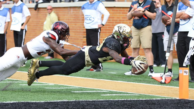Oct 28, 2017; Winston-Salem, NC, USA; Wake Forest Demon Deacons wide receiver Greg Dortch (89) dives for a touchdown in the second quarter against the Louisville Cardinals at BB&T Field.