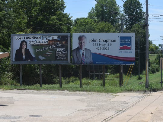 Mountain Home officials would like to see a circuit court judge order the removal of the right-hand billboard shown above. The sign was blown down during a April storm, but was quickly repaired by the billboard's owner. The city's billboard ordinance does not permit new signs to be built in the city and calls for existing billboards to be removed when they suffer serious damage.