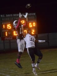 Peabody wide receiver Thomas Miles (12) tries to catch