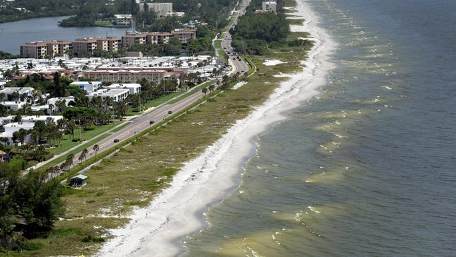 Red tide can be seen along the coast of Anna Maria Island and Longboat Key in this aerial photo from August 2018, during the last major bloom of the noxious algae.