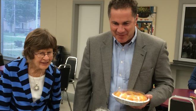 Democratic Senate candidate Bruce Braley, right, and his mother, Marcia Braley, campaign at South Side Senior Center in Des Moines.