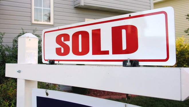 Stock image of a sold sign.
