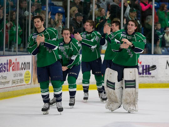 Plymouth Whalers players circle the ice at Compuware