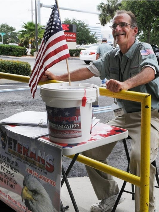 James Welborn solicits donations for a veterans support organization outside Walgreens on Babcock St. in Melbourne.