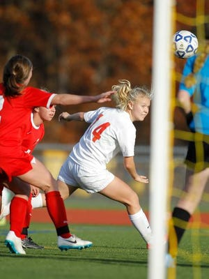 Somers' Melina Couzis (14) works a header toward the goal off a corner kick during the Tuskers' 1-0 win over Goshen in the Class A regional final at Arlington High School on Sunday.