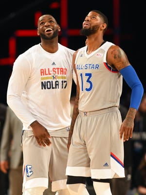 Feb 19, 2017; New Orleans, LA, USA;  Eastern Conference forward LeBron James of the Cleveland Cavaliers (23) and  Eastern Conference forward Paul George of the Indiana Pacers (13) after the 2017 NBA All-Star Game at Smoothie King Center. Mandatory Credit: Bob Donnan-USA TODAY Sports